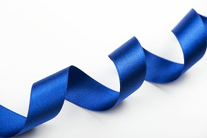 Abstract blue ribbon background on white background. Copy space.