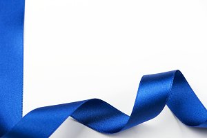 Abstract blue ribbon background on white background. Copy space. Isolated.