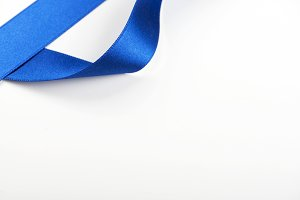 Blue ribbon background on white background. Copy space.