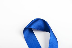 Blue ribbon on white background. Copy space. Background.