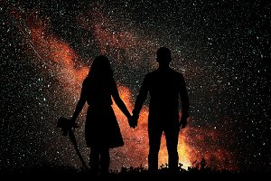 The silhouette of lovers against the backdrop of bright golden star. Love watching the sky.