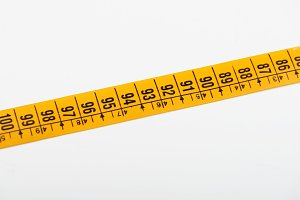 Yellow tape measure on white background. Isolated.