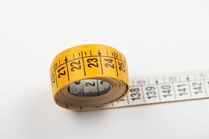 Tape measure white on white background. Copy space. Horizontal shoot.