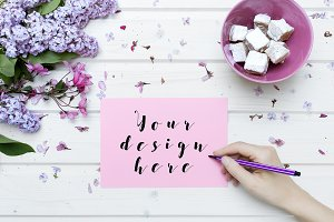White tabletop scene with pink paper