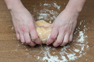 Woman kneading, baking cookies