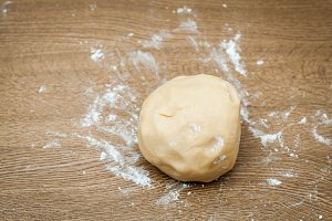 Cookies or bread dough in the table