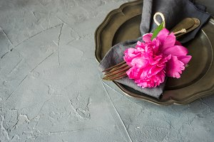 Summer table setting with peonies