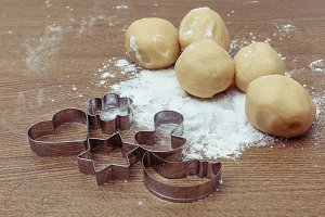 Raw cookie dough, flour and cutters