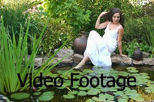 Girl rests on the shore of a pond