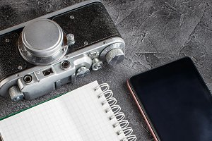 Notebook with film camera.