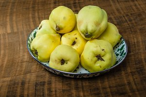 Quince fruit in metal bowl