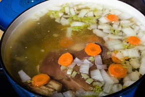 Vegetable ham soup cooking on the stove
