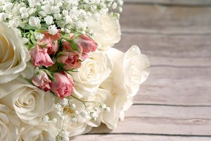 Pink and White Rose Bouquet on wood