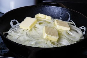 Onions cooking with butter in skillet