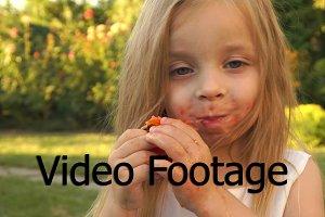 Little girl enjoys eating tomato