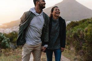 Smiling couple walk