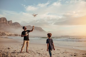 Father and son operating drone