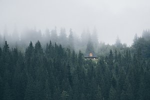 Little house on a green mountain slope