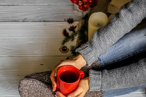 Warm and cozy,  concept of the girl's feet in  socks with a Cup  tea