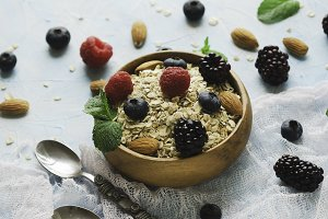 Healthy breakfast with oat flakes, raspberry berries, blueberries, selective focus