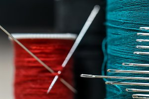 Sewing threads of different colors with lots  needles