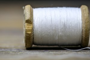 Sewing thread white color with a needle