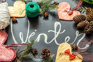 Chalk inscription winter on black Board holidays