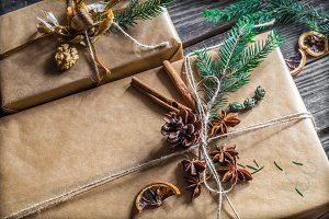 beautifully Packed with gift on wooden background