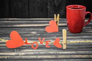 word love made of paper and red Cup