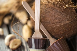 chocolate with coconut on wooden background