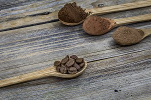 beautiful little wooden spoon with coffee on  background