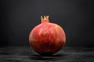 whole pomegranate on  black background