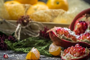 still life with tangerines and pomegranate