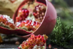 still life with open pomegranate