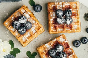 Belgian waffles with fresh berries and mint