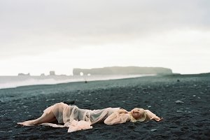 Girl in Pink on Black Sand Beach