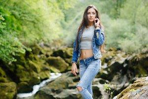 long hair woman posing in mountains