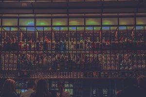 Rows of hard liquor bottles at a bar