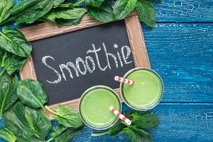 Detox green smoothie with spinach, pineapple, banana and yogurt, horizontal, top view, copy space
