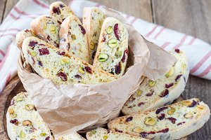 Biscotti with cranberry and pistachio in vine basket, closeup