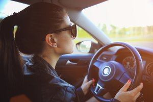 Woman driving new car lifestyle