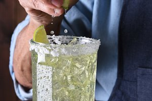 Bartender Squeezing Lime