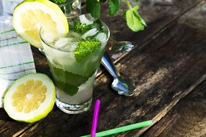 Glass of mojito on rustic table