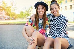Two cheerful friendly confident young women