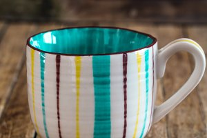 The striped Cup on wooden background