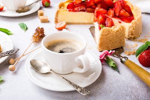 Cup of cooffee and strawberry cheesecake