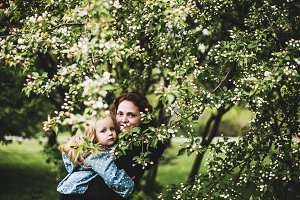 mother and daughter in Apple trees