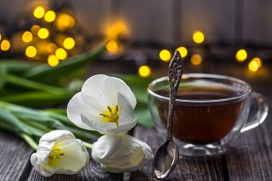 white tulips and a Cup of tea