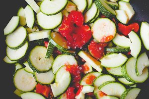 Zucchini with tomato, faded vintage look