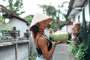 Woman holding coconut
